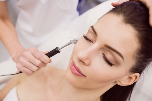 dermatologist-performing-laser-hair-removal